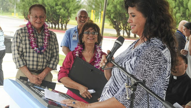 Lourdes Reyes, center, and her husband, Tomas Reyes, left, are recognized as distinguished retirees by Port Authority of Guam General Manager Joanne Brown during the flag raising ceremony at the Jose D. Leon Guerrero Commercial Port in Piti on Monday, Oct. 19. Lourdes started working at the port in 1969 and retire after serving 25 years with the agency. Tomas, began work for GovGuam in 1971, joined the port in 1984 and retired as a preventive maintenance mechanic in 1992. The agency is celebrating Port Week and 40 years of service to Guam and the region.