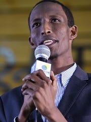 Nashville immigrant advocate Mohamed Shukri Hassan speaks at the Nashville Storytellers event at the Nashville Farmers' Market on April 25, 2016.