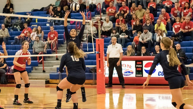 Central Catholic's Sami Royer sets the ball to Libby Bonner (18) in the Knights' semistate semifinal match against Seton Catholic.