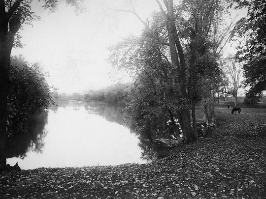 """View of Otter Creek, Middlebury, c. 1885. Verso: """"Otter Creek from Grandpa's lot, P. Battell."""" By Ruluff A. Dean, local photographer."""