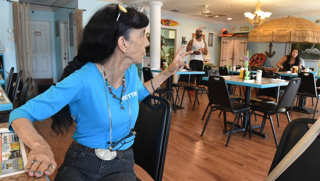 "Dottie Stonestreet (left), owner of the new Lenzi's Diner at 901 Avenue D in Fort Pierce, gives directions to her staff, Deandre Gaskin, head cook (center), and her manager Destiny Isenburg on Thursday, July 19, 2018, as they prepare the restaurant for their opening day. ""I just can't wait to be part of this community,"" Stonestreet said. ""I so look forward for the community to coming down and seeing us."""