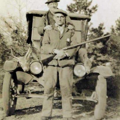 Warden Harry M. Loveless (seated) with Deputy Michael