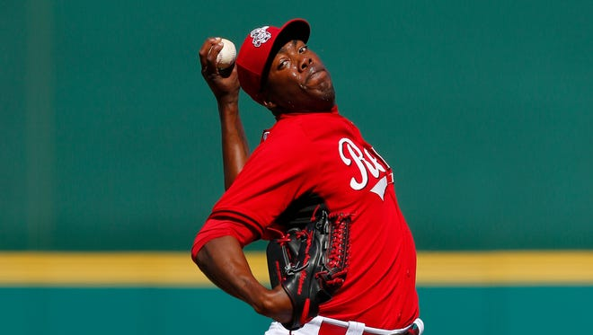 FILE - Cincinnati Reds pitcher Aroldis Chapman throws against the Seattle Mariners during an exhibition baseball game in Goodyear, Ariz., Monday, March 3, 2014. (AP Photo/Paul Sancya)