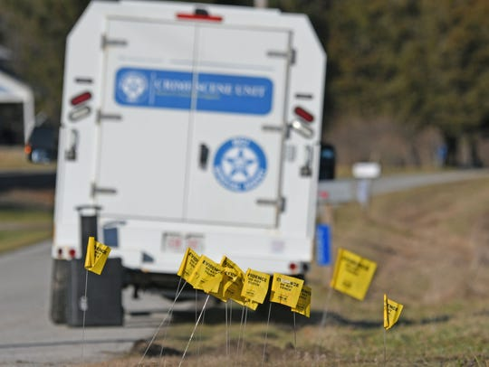 Evidence flags litter the scene of fatal shooting involving