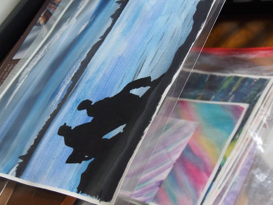 Stacks of watercolor backgrounds stand awaiting further