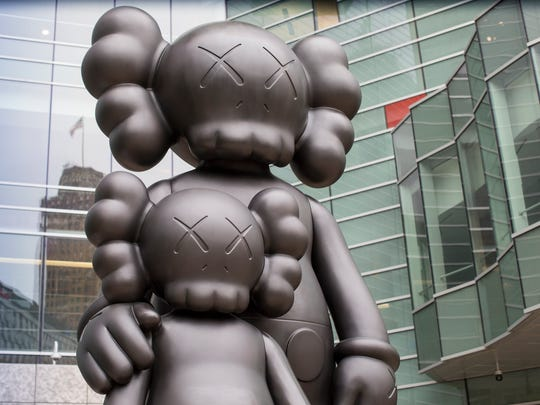 """Waiting"" by artist Kaws overlooks Campus Martius in Detroit, Sunday, May 20, 2018."