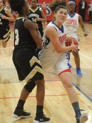 Cooper's Cheyenne Sherwood, right, drives against a