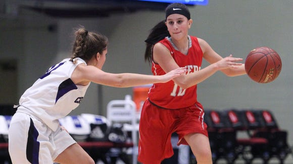 Somers' Dani DiCintio is pressured by Monroe-Woodbury's Willow Duffell during their championship game of the Slam Dunk Tournament at the Westchester County Center Dec. 27, 2016.