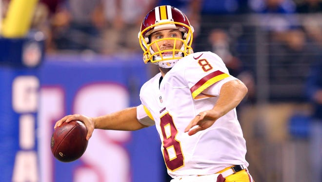 Washington Redskins quarterback Kirk Cousins (8) passes against the New York Giants during the first quarter at MetLife Stadium.