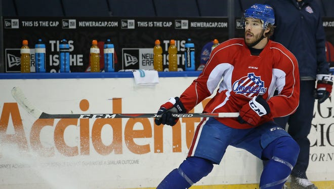 Rochester American's defenseman Zach Redmond hits the brakes during drills during the team's practice Tuesday, April 17, 2018 at the Blue Cross Arena at the War Memorial in Rochester.