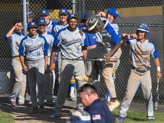 Manchester's Jarvas Smith celebrates with team mates after sliding home for his team's first run of game. Manchester vs Southern Regional in Ocean County Tournament Semifinal game on May 16, 2017 in Stafford NJ