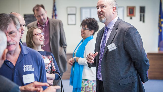 MCS superintendent Dr. Steven Baule chats with attendees of a meet and greet at the Anthony Administration Building Wednesday afternoon.