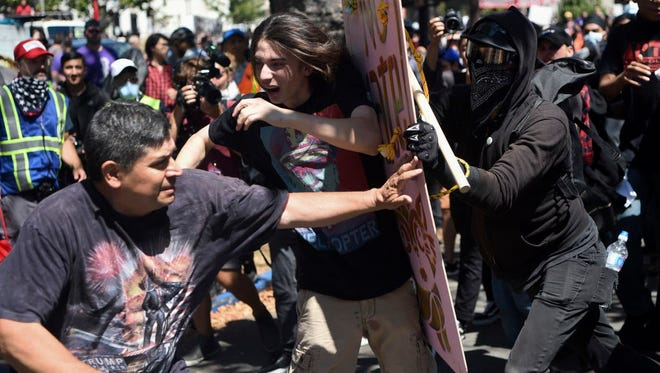 """Demonstrators clash during the """"Rally Against Hate"""" in Berkeley, Calif., on Aug. 27, 2017."""