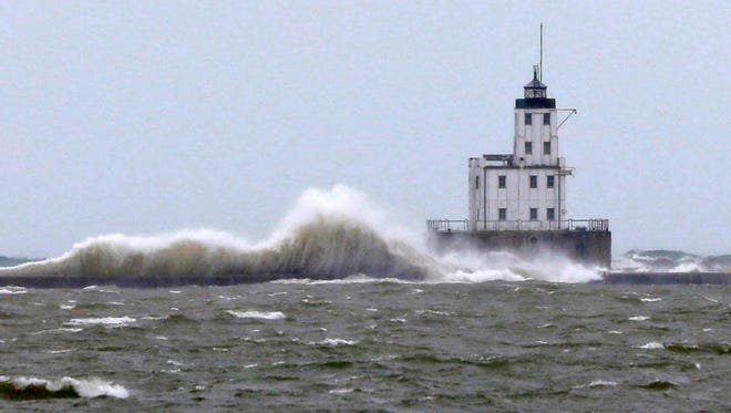 Waves crash around the breakwater light lighthouse on Lake Michigan in Milwaukee on Oct. 26, 2016. The National Weather Service is forecasting potential gale-force winds on Lake Michigan this weekend.