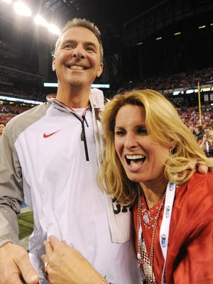 Shelley Meyer, right, says her husband, Urban, is living a healthier lifestyle since returning to coaching with the Ohio State.