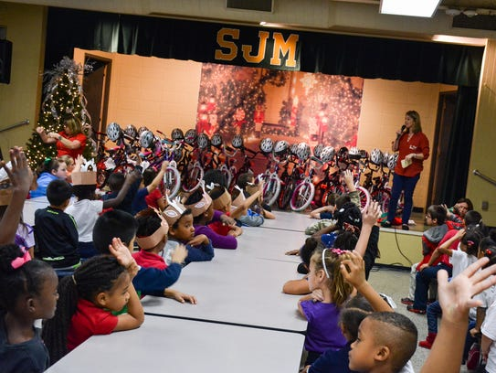 Academy Sports and Outdoors donates bikes and helmets to S.J. Montgomery Elementary students. The school is now overcrowded, with more than 800 students.