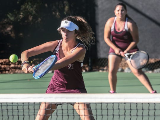 Rancho Mirage's number number one doubles team of Zoe Kolytiris, front, and Karla Munoz in action against the Hemet team of Heidi Buri and Simone Springs at the CIF Southern Section Division 5 Championships in Claremont on Friday, November 11, 2016. Rancho Mirage lost the set 3-6.