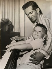 Bill Shoemaker and son John practice a duet on the piano, circa 1957.
