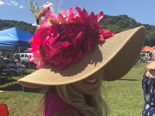 Crystal Marie adds a flamingo, the perfect surprise addition to her floral decked hat.