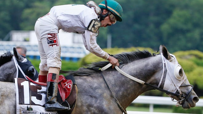 Jockey Irad Ortiz Jr., riding Creator, celebrates after winning the 148th running of the Belmont Stakes horse race, Saturday, June 11, 2016, in Elmont, N.Y. (AP Photo/Kathy Willens)
