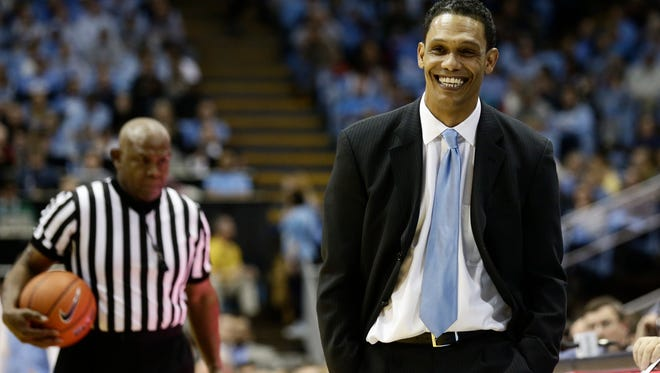 Monmouth head coach King Rice reacts during the second half of an NCAA college basketball game against North Carolina in Chapel Hill, N.C., Wednesday, Dec. 28, 2016. North Carolina won 102-74. (AP Photo/Gerry Broome)