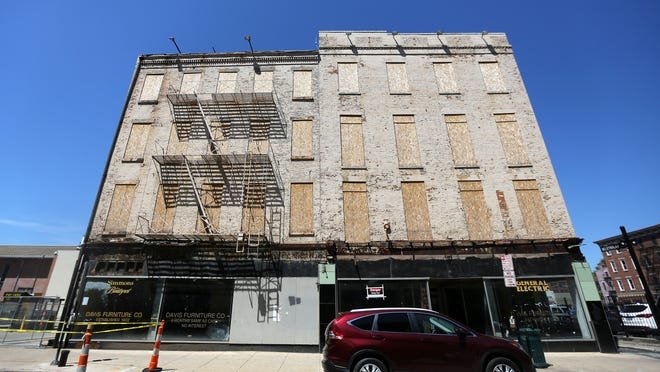 The Stough Group, which owns the Davis Building on Main Street in Over-the-Rhine, says the structure cannot be renovated for a reasonable cost and wants to tear it down.