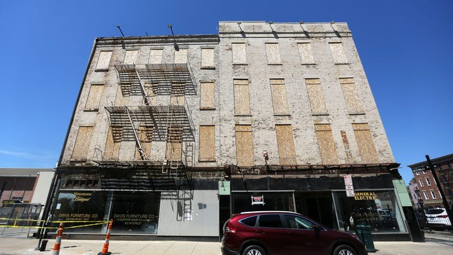 The Stough Group wants to tear down the Davis Building, a former furniture store on Main Street in Over-the-Rhine, saying it would cost too much to rehab.