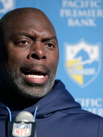 FILE- In this Jan. 13, 2019, file photo, Los Angeles Chargers head coach Anthony Lynn speaks to the media following an NFL divisional playoff football game against the New England Patriots, in Foxborough, Mass. Chargers coach Anthony Lynn has a busy stretch ahead before his team begins training camp in late July. He will be opening a new school in Africa, hold his own golf tournament and visit with the first responders who saved his life in 2005. (AP Photo/Steven Senne, File)