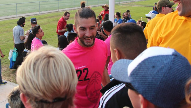 Guam Matao goalkeeper Dallas Jaye interacts with spectators after the team's 2018 FIFA World Cup Russia and AFC Asian Cup UAE 2019 Joint Preliminary Qualification Round 2 match against Oman, played on Sept. 8, 2015 at the Guam Football Association National Training Center. Jaye recently signed a professional contract to play for USL side FC Cincinnati.