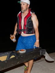 Wes Wyatt helps carry the canoe at the end of the race