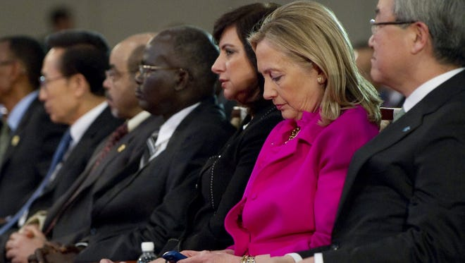 Secretary of State Hillary Clinton checks her phone in Busan, South Korea, in 2011.