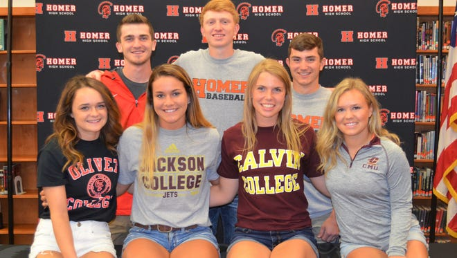 Seven athletes from Homer High School signed to play their respective college sports on Wednesday, including, front row, from left, Breanna McCone, Aleea Coulter, Megan George, Lillie Smith and back row, Joe Roth, Jordan Sherman and Kyle Klepper.
