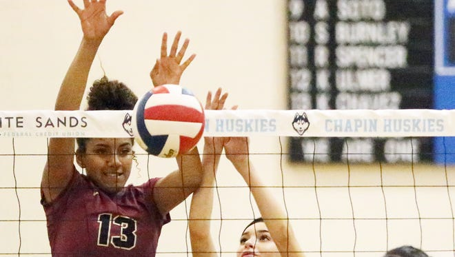 Ebonie Ballesteros, 13, of El Dorado rejects a shot by Chapin's Jessica Landeros Tuesday night a Chapin. Helping was teammate Paige Mcgriff, 2. The Aztecs fell to the Huskies in four sets.