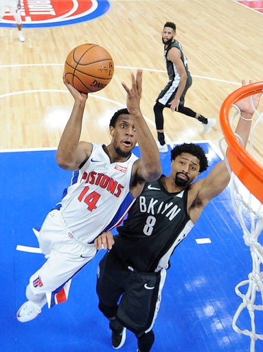 Pistons' Ish Smith shoots over Nets' Spencer Dinwiddie