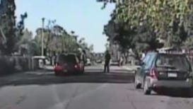 This screengrab taken from a video provided by Sacramento police, shows and officer just before getting into an altercation with a man suspected of jaywalking.