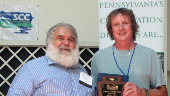 Glenn Seidel, left, president of the Pennsylvania Association of Conservation Districts, presents the Conservation District Employee Excellence Award to Karl Kercher, assistant manager of the Lebanon County Conservation District.