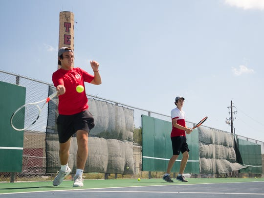 Ray High School tennis doubles team Carl Hilliard and George Webster warm up during practice on Wednesday, May 9, 2018.