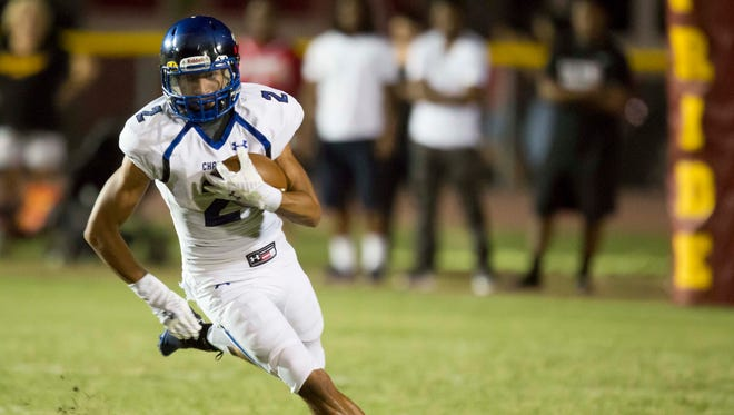 Chandler Wolves Junior Chase Lucas (2) turns up field for a gain in the game against Mountain Pointe, Friday, September 19th, 2014, in Phoenix, Ariz.