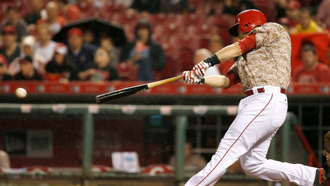 Cincinnati Reds catcher Devin Mesoraco (39) singles in the eighth inning during the Major League Baseball game between the Cincinnati Reds and the San Francisco Giants, Saturday, May 16, 2015, at Great American Ballpark.
