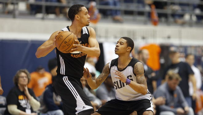 Phoenix Suns' John Jenkins looks to pass while being guarded by Tyler Ulis during a preseason scrimmage at Walkup Skydome at Northern Arizona University in Flagstaff on October 2, 2016.