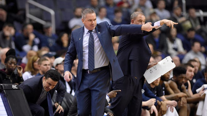 Butler head coach Chris Holtmann, front, points during the first half of an NCAA college basketball game against Georgetown, Saturday, Jan. 7, 2017, in Washington.