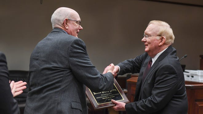 Billy Wilkins, right, presents Greenville County Sheriff's Office investigator James Phillip Perry with the 2018 Billy Wilkins Award For Excellence In Law Enforcement during a ceremony in Greenville Thursday, May 3, 2018.
