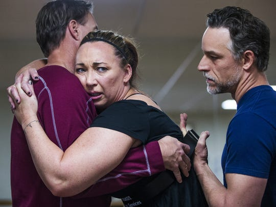 Amy Van Dyken Rouen falls into the arms of  her husband,