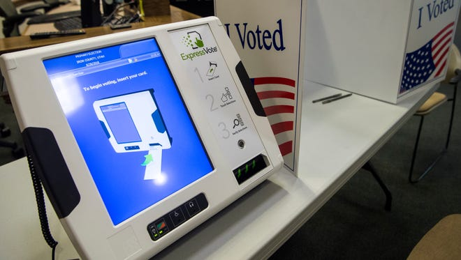 A new electronic voting machine stands available at the Cedar City Office Tuesday, June 26, 2018. The machine helps voters who would have difficulty filling out a traditional paper ballot.