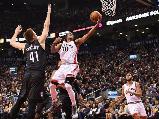 636200262616342011-AP-Nets-Raptors-Basketball.jpg