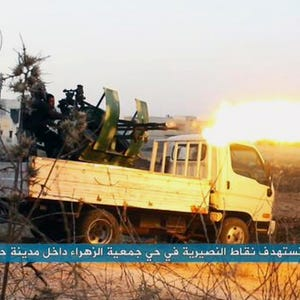 French warplanes 'totally destroyed' Islamic State camp in Syria 635788072640627610-AP-MIDEAT-SYRIA-76158164