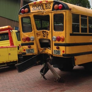 Naked woman a passenger in truck that slams school bus
