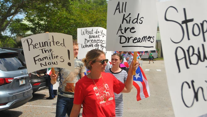 Approximately 70 people showed up Wednesday at the Government Complex in Viera, outside Congressman Bill Posey's office, to protest recent immigration policies and the treatment of Puerto Rican evacuees from Hurricane Maria.