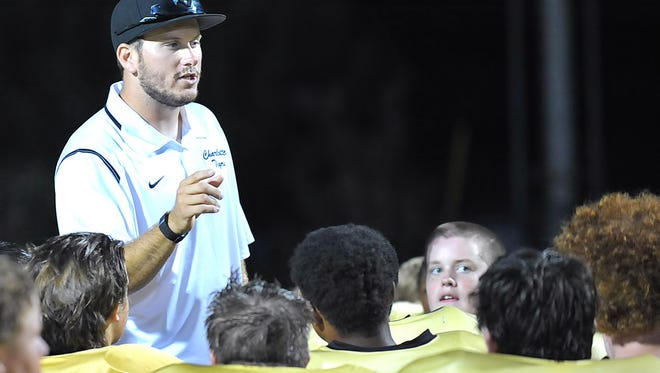 Charlotte Head Coach Houston Thiel congratulates his team after the win over CPA in Week 3. The Tigers blasted East Hickman Thursday to improve to 7-0.