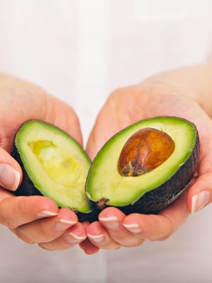 Rioe avocados are green-black in color and give gently when pressed.